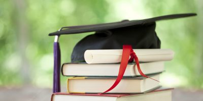 Graduation Cap and Diploma Concept